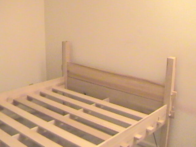 assembled bed, looking towards head board